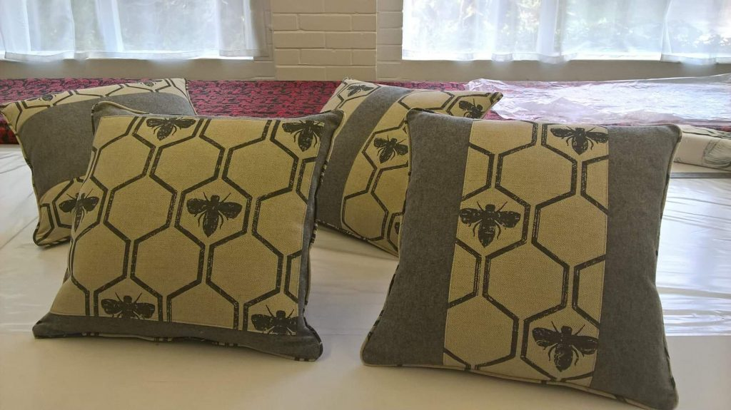 Individual bee patterned cushions made by Tovey Mead of SewTovey