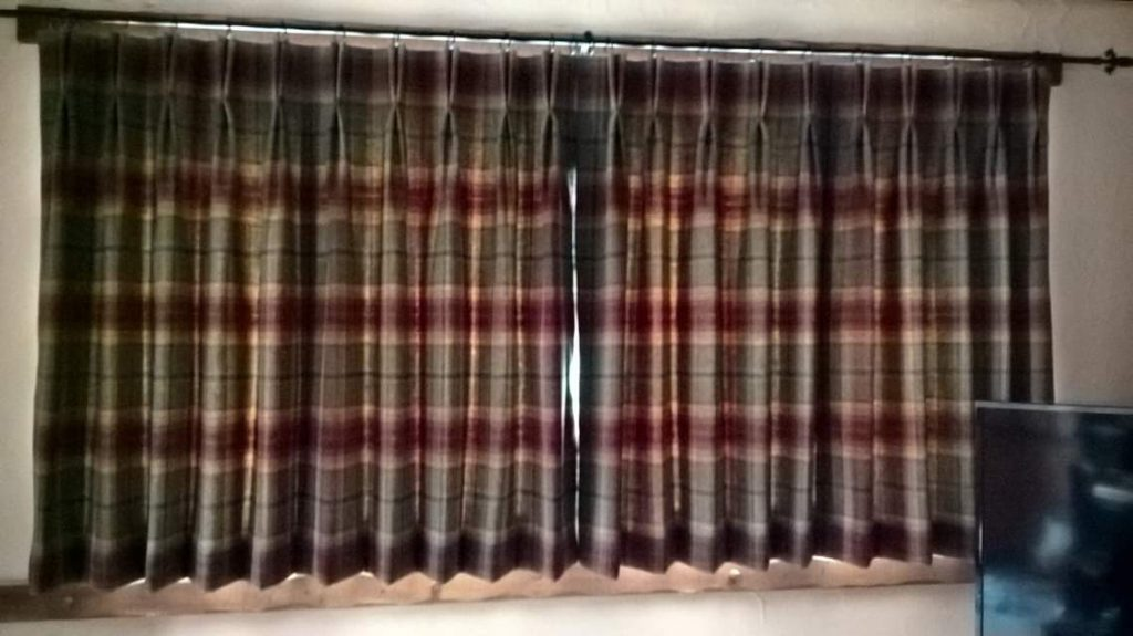 Pleated curtains by Tovey Mead of SewTovey